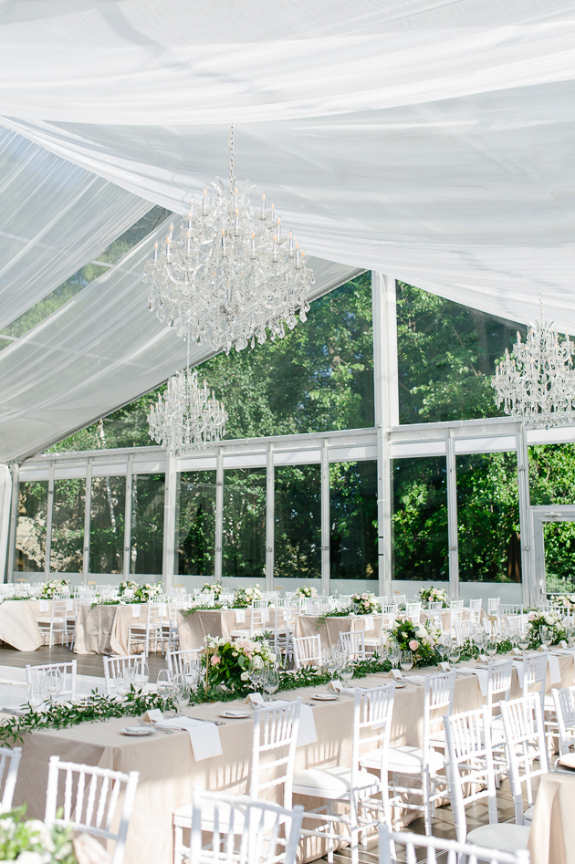Casa Loma Wedding in Toronto, inside the glass pavilion with beautiful table settings, accents of blush, white, and green bringing connecting the outside natural beauty of the estate gardens indoors.