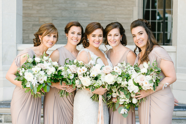Casa Loma Wedding in Toronto, portrait photography of the radiant bride with her bridesmaids.