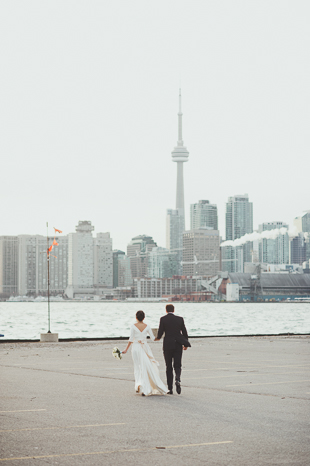 Candid Wedding Photographer. Portrait photography the bride and groom with Toronto's skyline.