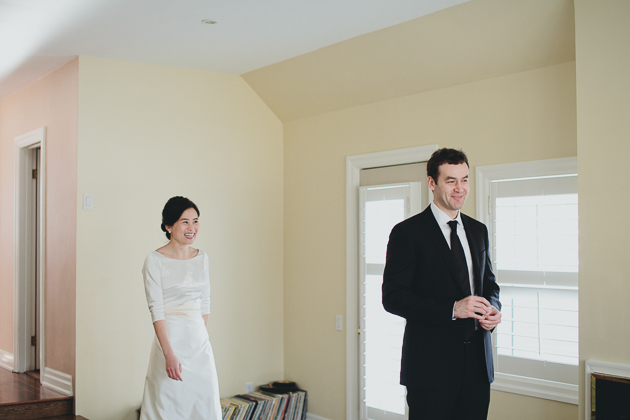 Candid Wedding Photographer. The couple's first look in their home.