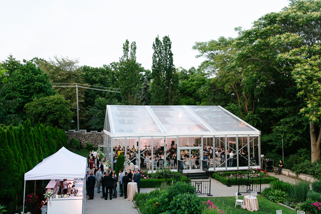 Casa Loma Wedding Toronto, exterior photo of the glass pavilion surrounded by the estate gardens in summertime.