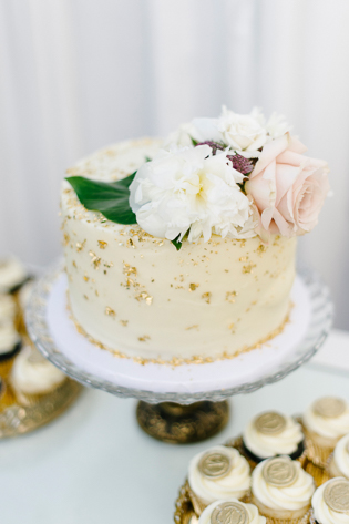 Casa Loma wedding Toronto, wedding details photography. Summer wedding cake with gold flakes, topped with flowers.