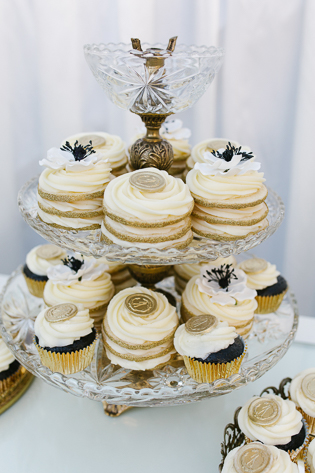Casa Loma wedding in Toronto, wedding details photography. Chocolate cupcakes topped with butter cream and gold filling.
