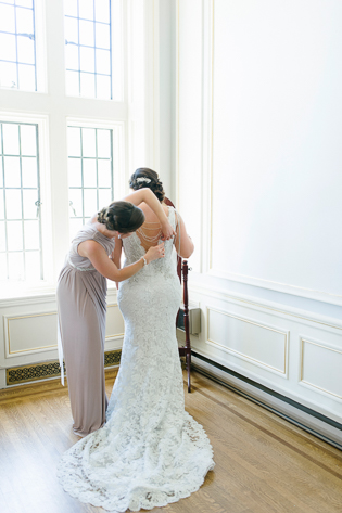 Casa Loma Wedding Toronto, quiet moments captured of bride getting a helping hand with final touches.