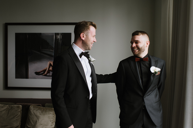 The Chase Toronto Wedding Venue. Gay wedding portrait photography of the grooms after seeing each other for the first time.