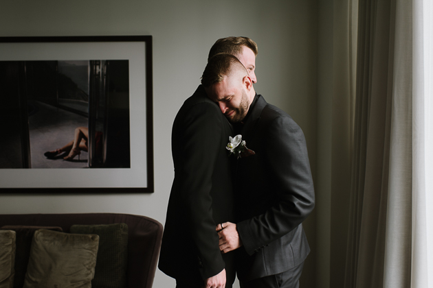 The Chase Toronto Wedding Venue. Gay wedding portrait photography of the grooms after the first look.