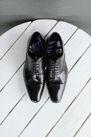 Muskoka Wedding Toronto Photography. Wedding details photography of groom's shiny black kicks and stripped socks.