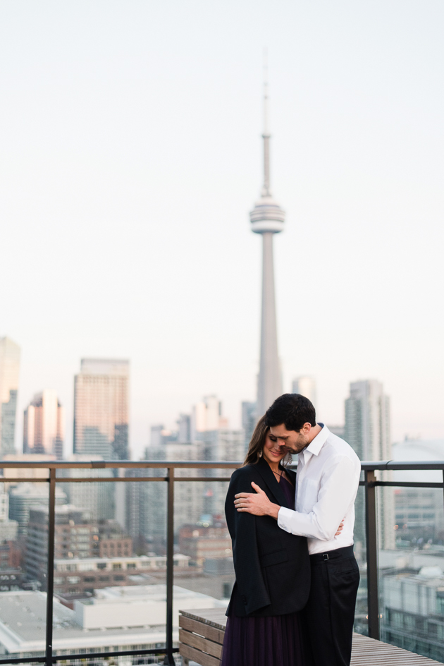 Chez Lavelle Rooftop Toronto Couple's Photography. The happy couple immersed in the afterglow of a beautiful proposal.