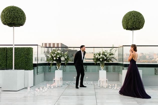 Chez Lavelle Rooftop Toronto Couple's Photography. The moment she realizes why she's on the rooftop with a gorgeous view of our city and her fiance-to-be.