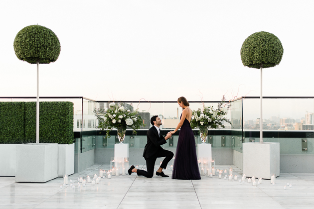 Chez Lavelle Rooftop Toronto Couple's Photography. Proposal photography, the moment he got down on one knee.