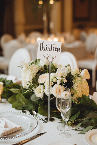 Liberty Grand Wedding Photography. Wedding details photography of guest table settings with handwritten table number signs.