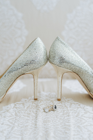 Liberty Grand Wedding Details Photography. Photo of bride's rings and wedding heels.