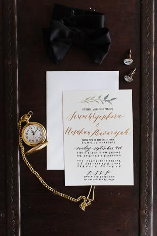 Toronto Wedding Photography. Groom outfit details, gold pocket watch, cuff links, black bow tie and wedding invitation card.