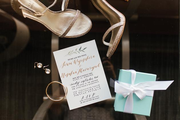 Toronto Wedding Photography. Bride getting ready photo session; bride's heels, diamond earrings, tiffany box and personalized wedding invitation.