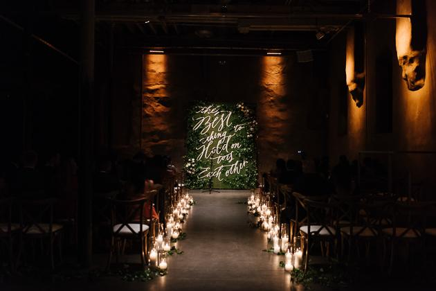 Fermenting Cellar Toronto Wedding Photography. Dramatic candlelit lined path to the wedding alter.
