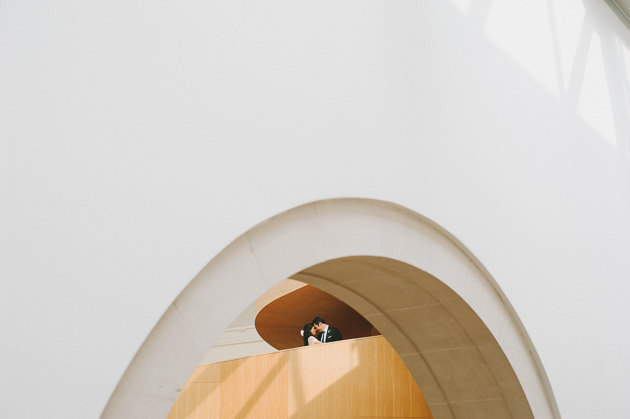 AGO Toronto Wedding Photography. Creative photo session with the couple shown here framed uner an archway.