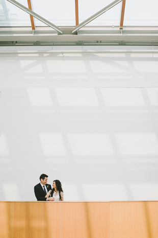 AGO Toronto Wedding Photography. Creative photo session with the couple framed by the simple architectural geometric lines and neutral colour palette.