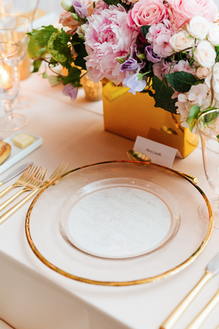 AGO Toronto Wedding Photography. Blush florals, gold accents and mauve table cloths create a sweet, elegant and stylish decor. Gold rimmed charger plates with gold cutlery.