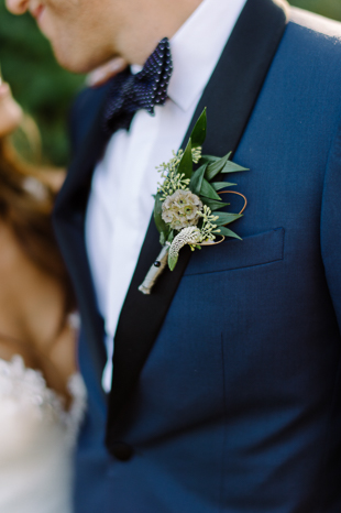 Groom's boutonniere is on point