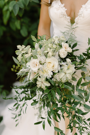 Organic lush greenery and white roses bouquet at Holcim Estate wedding