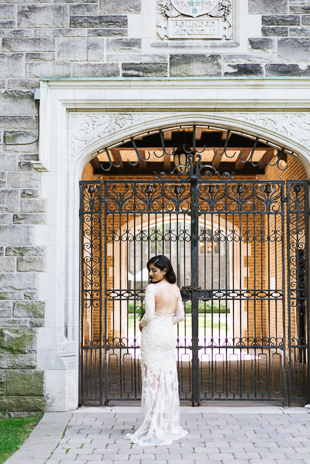 U of T Editorial Wedding Photographer. The bride glances back showing off her stunning open back lace wedding dress.