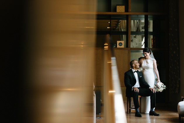 a bride and groom posing in the lobby of the Le Germain hotel