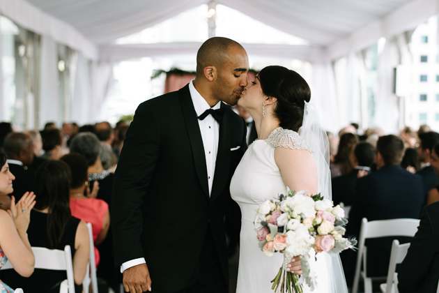 a bride and groom kissing for the first time as husband and wife at Malaparte