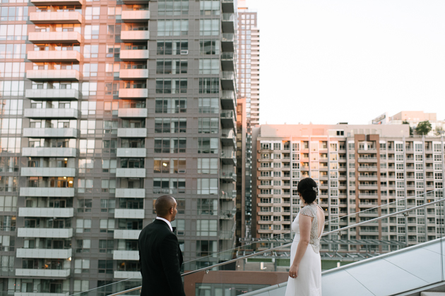 a bride and groom watching the sunset at Malaparte