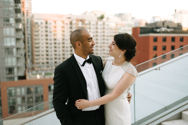 bride and groom exchanging happy smiles at the rooftop of Malaparte