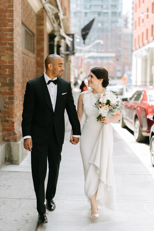 a happy couple walking down the streets of Toronto