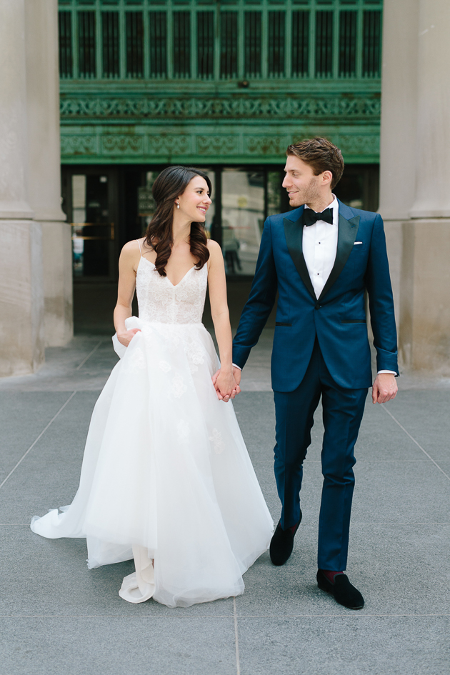 Bride and groom walking happily after their ceremony at Fairmont Royal York