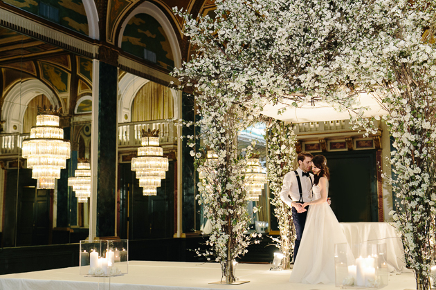 bride and groom sharing an intimate moment seconds after their wedding ceremony at fairmont royal york
