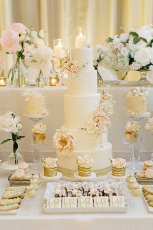 white and blush cake at fairmont royal york wedding