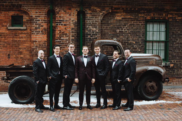 Fermenting Cellar Toronto Wedding. Outdoor creative portrait session with the groom and his groomsment. Exposed aged brick walls, an old rusty truck and paved streets create a texturally rich and warm backdrop.