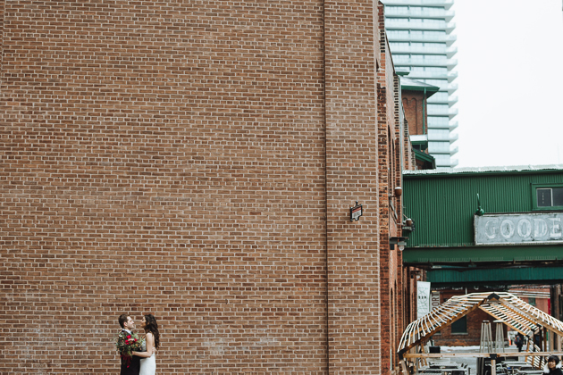 Fermenting Cellar Toronto WeddingFermenting Cellar Toronto Wedding. Outdoor creative portrait session with the bride and groom in the Distillery District against a brick wall backdrop.