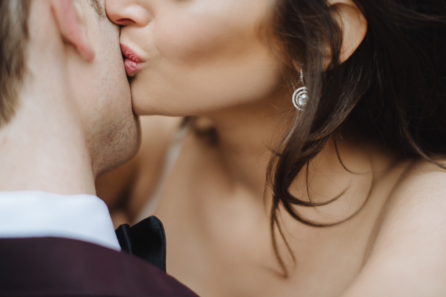 Fermenting Cellar Toronto Wedding Photographer. A close up photo of the bride kissing her groom's cheek.