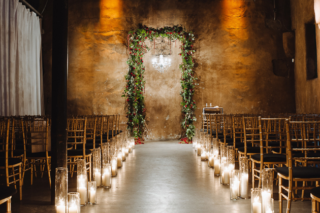 Fermenting Cellar Toronto Wedding Photographer. Candlelit lined pathway to a floral framed altar.
