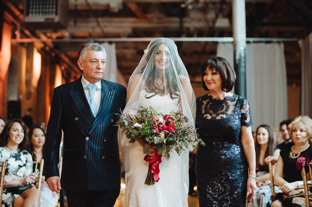 Fermenting Cellar Toronto Wedding Photographer. The parents walk the veiled bride down the aisle to her groom.