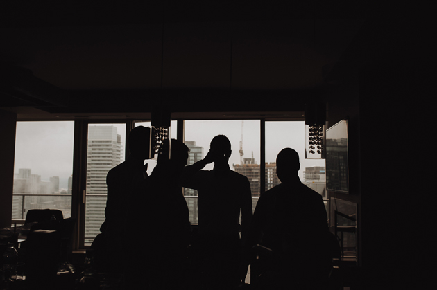 Fermenting Cellar Toronto Wedding Photography. The groomsmens' silhouettes against the city background.