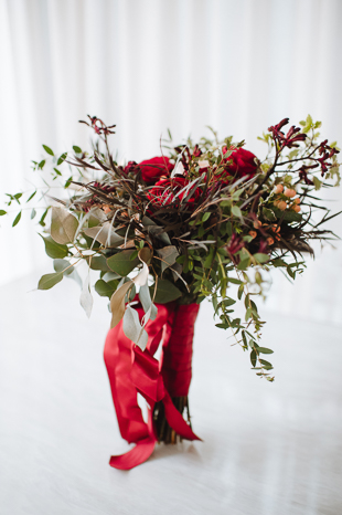Fermenting Cellar Toronto Wedding Photography. Wild, romantic boquet with red roses and red ribbon.