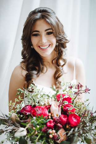 Fermenting Cellar Toronto Wedding Photography. Creative portrait photography session with the smiling bride and her wild romantic bouquet.