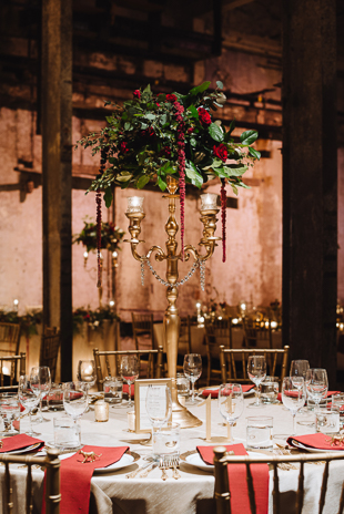 Fermenting Cellar Toronto Wedding Photographer. Idustrial chic and romantic wedding venue with exposed structural beams. Gold, peach and red accents colour the guest tables.