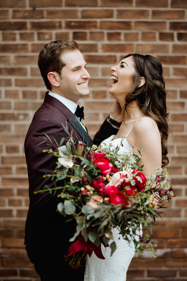 Fermenting Cellar Toronto WeddingFermenting Cellar Toronto Wedding. Outdoor creative portrait session with the bride and groom in the Distillery District captured here sharing a laugh against a brick wall backdrop.