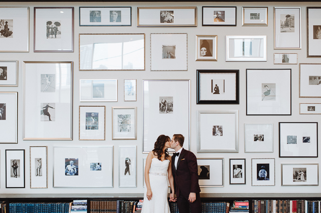 Fermenting Cellar Toronto Wedding Photography. Creative portrait photography of bride and groom against a beautifully styled gallery wall.