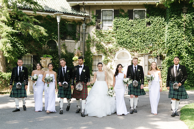 Eagles Nest Golf Club Wedding Venue. Toronto Photojournalistic Wedding Photographer. Portrait photography of the bridal party in white dresses and scottish kilts.