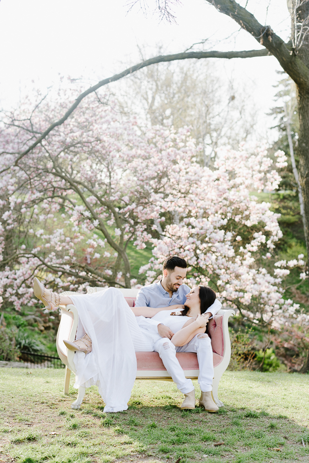 Bride and Groom spending an afternoon at High Park during their engagement photo shoot under a cherry blossom