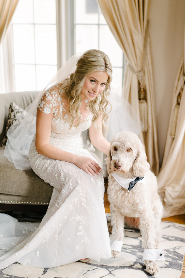 a bride and her favourite dog taking pictures in the morning