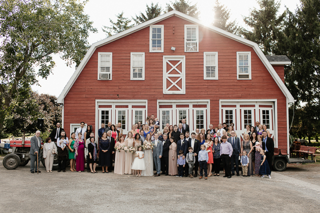 Barn Wedding Venue. Family portrait photography of bride and groom's family post ceremony.