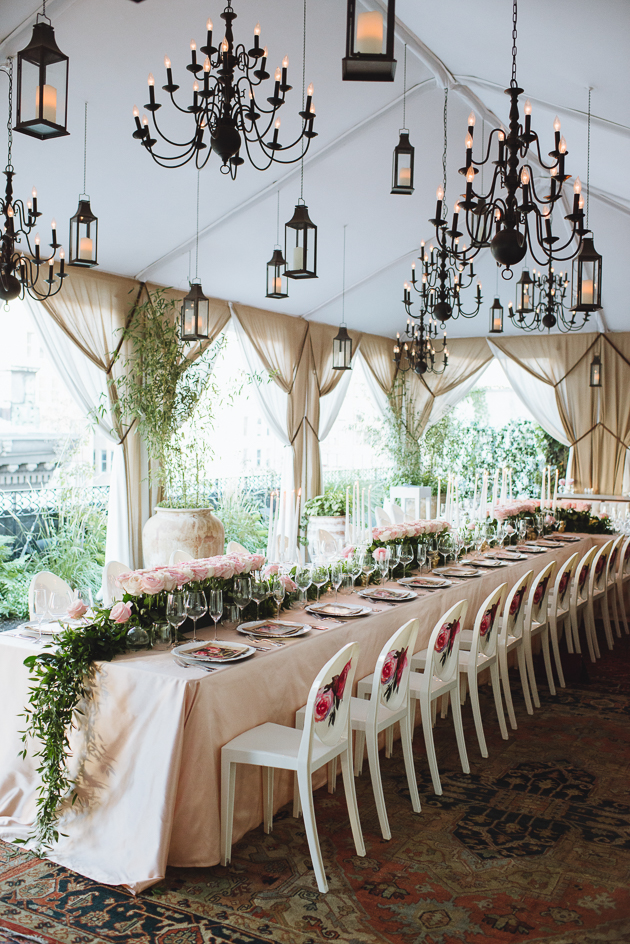 No Mad New York City Wedding Photography. Urban chic restaurant weddings. Tented wedding reception with carpeted floors, hanging black lanterns and chandeliers.