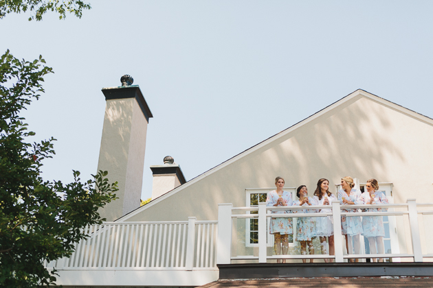 Bridesmaids hanging out on balcony at Toronto Hunt Club